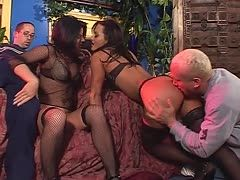 Two horny bitches enjoy a foursome