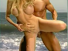Baywatch beauty with XXL boobs has anal sex on the beach