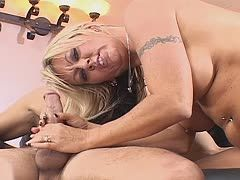 Milf jerks the cock