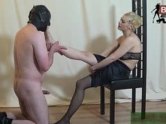 Naked slave is allowed to lick the feet of his dressed German mistress