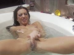 Sister rubs her cunt in the bathtub and orgasms loudly