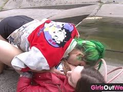 Amateur lesbians eat out their pussies outdoors