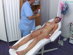 Gynaecologist examines her tits