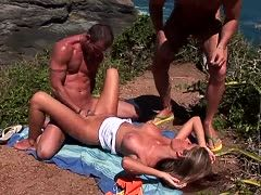 Two suntanned boys fuck a brunette