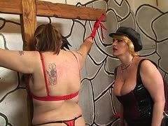Chubby slut is bound to the cross