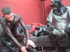 Slaves squeeze into their latex suits