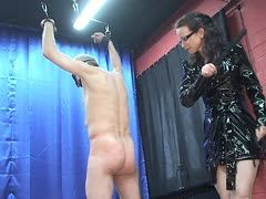 Riding crop lands with a smack on the male slave's ass