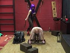 Annika Bond whips him as dominatrix