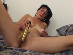 Golden dildo slides into the hole