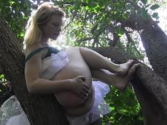 Madison Young masturbates in the forest