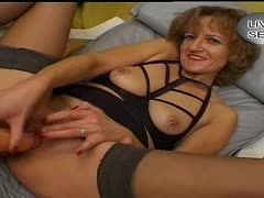 Young granny plays again with her anal dildo