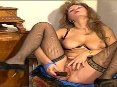 Uschi helps Gitta with the dildo
