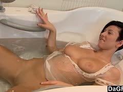 Short-haired babe satisfies herself in the bathtub